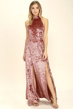You'll always end up picking the Sway My Options Rusty Rose Velvet Maxi Dress! Luxurious, crushed velvet, in a unique rose shade, shapes a high halter neckline with two snap closures and a strappy, elasticized open back. Princess seamed bodice tops a maxi skirt with two sexy side slits. Hidden back zipper/clasp.