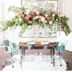 Whenever my brides/planners ask 'can you hang flowers here?' referring to odd spots that seem near impossible to place a water source the answer is simple. puts sassy pants on If I can apply tape wire zip ties or floral adhesive it can have flowers on it! My absolute FAVORITE thing to do is create large floral installations (arbors chuppahs floral ceilings walls chandeliers). I loved 3D design when I was in art school and doing large scale floral pieces for wedding spaces is like combining…