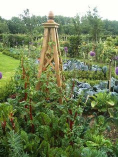love the obelisk in this beautiful garden