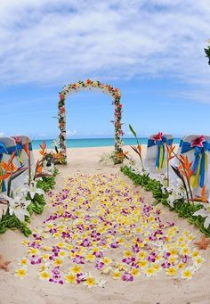 Beach wedding arch decoration, Yellow frangipani flowers with purple wild orchisa laying the pathway for the bride www.loveitsomuch.com