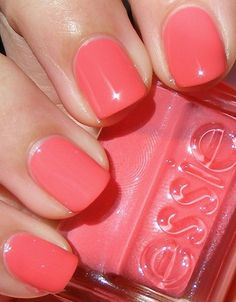 Coral colored Essie nail polish (Photo only).