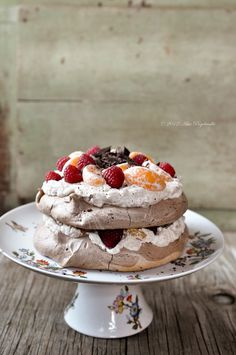 chOcOlate pavlOva chestnut creme raspberries clementine