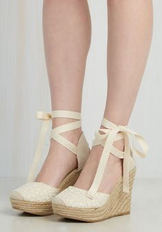 Whether you dress these espadrille wedges up with all-black attire is up to you, but either way, their cream and light tan color scheme boasts thrilling versatility! Once you slip into the macrame-inspired floral lace of these braided heels, you'll jump joyously over their adorable design.