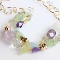 Hey, I found this really awesome Etsy listing at http://www.etsy.com/listing/91467648/multi-gemstone-necklace-amethyst-citrine
