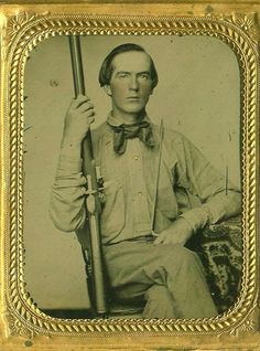 Confederate soldier with a converted flintlock rifle of unknown maker, holding a bayonet.