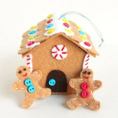 Make this felt gingerbread house ornament. Take off the roof and little gingerbread people live inside!