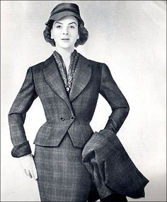 A sophisticated plaid skirt suit with matching overcoat from 1954.
