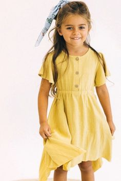 bd2c2c1359c Brighten up your little girl s day with this sunny yellow dress! She will  love the