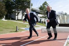 "International Olympic Committee President Thomas Bach talk with Swiss Federal Council member Ulrich ""Ueli"" Maurer improvise a track and field race outside the Olympic Museum in Lausanne, during. Get premium, high resolution news photos at Getty Images Olympic Committee, April 10, Lausanne, Track And Field, Olympics, Presidents, The Outsiders, Museum, Image"