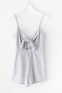 Pinstriped baby blueromper with a knot and cut-out front. Made with excellent quality cotton blend material that is non-stretch. Adjustable spaghetti straps. Fully lined with a back zipper for easy on and off closure.  45% Cotton 55% Linen Imported