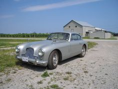 This 1953 Aston martin DB2/4 has been under the same ownership for the last 35 years. These early examples are very hard to find especially with no rust like this one. It runs and drives but is in need of some interior work. It also comes with a lot of paperwork. Silver with Ivory interior. A very original car for only $189,500 #gullwingmotorcars #classiccars #buy&sellclassiccars #VintageCarBuyer #ClassicCar #antiqueCarBuyer #AstonMartin #1953AstonMartinDB2/4