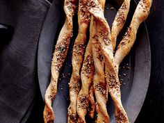 Whole-Wheat Seeded Breadsticks | Let's all be honest, while turkey may get all the Thanksgiving attention, the real stars of the meal are the side dishes. They spread on the dinner table, handed from guest to guest for a dollop of this or serving of that, and end up taking up the majority of your plate. Dishes like roasted vegetables, fluffy dressing, creamy mashed potatoes, airy rolls, seasonal salads, and the classic green bean casserole all combine to bring your Thanksgiving together.