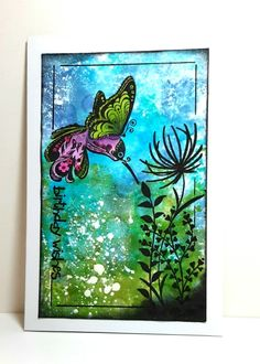 Spring hummer card by Francie (f.schles @ splitcoaststampers) She used the Smackin' Acetate technique several times to get deep color, then stamped & finally splattered w/ white paint using a toothbrush.