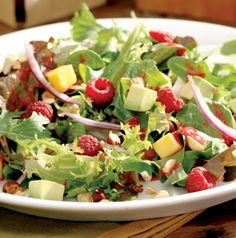 Raspberry, Avocado and Mango Salad just tastes like summer! What we love is that part of the raspberries go into the vinaigrette. So sweet and tangy.