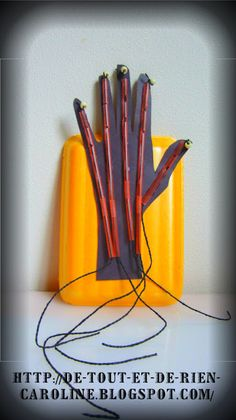 Movable hand craft to learn about tendons and hand anatomy--Pull the cord and move the hand!