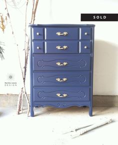 A Solid Wood Dresser Has Been Painted In Deep Blue And The Original Hardware