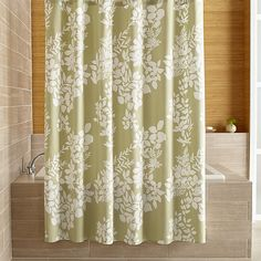 This graphic botanical print by Fujiwo Ishimoto scatters realistic white silhouettes on fresh spring green. This nature-inspired shower curtain creates a serene setting, especially when paired with matching Kukkula bath towels.