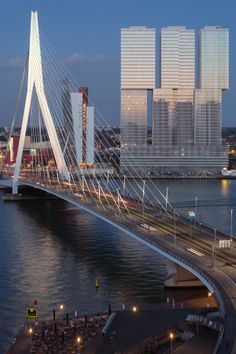 The Erasmus Bridge (Dutch: Erasmusbrug) is a combined cable-stayed and bascule bridge across the Nieuwe Maas, connecting the north and south parts of the city of Rotterdam, the Netherlands.  The 802-metre-long (2,631 ft) bridge was designed by Ben van Berkel and completed in 1996. #bridges