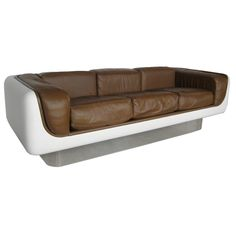 comfy stretched fiberglass and leather sofa, a classy 60s design