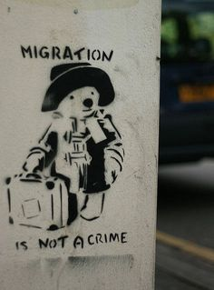"(Banksy) ""Migration is not a crime"" Bristol, UK / Street Art ( ) Street Art Banksy, Street Art Quotes, Banksy Graffiti, Graffiti Artists, Urbane Kunst, Bansky, Paddington Bear, Political Art, Arte Popular"