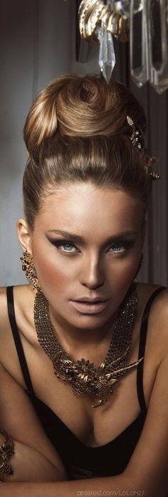 Check out this bronze goddess - LOVE the makeup, the hair, the jewelry... everything!
