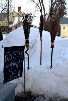 Broomstick parking. Obviously not in the snow since its July, but next to the front door on the left of the side walk maybe.