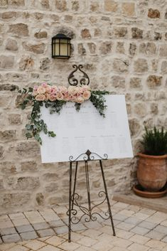 Wedding Seating Chart with Flowers | Romantic Pink & White French Riviera Wedding at Chateau Saint Jeannet | Sebastien Boudot Photography | Shoot Me Now Films