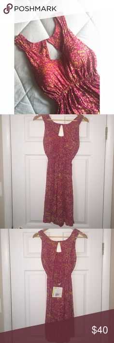 Beautiful Bright Patterned Open-Back Summer Dress This dress is NWT! Purchased about two years ago in a boutique in Turks & Caicos. Dress has an open back and comes with cups built in. The cups were too big for me. Colors are pink, yellow, and orange. Size is M. Very summery & so cute! Santiki Dresses