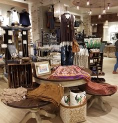 Don't have outfit ideas? Our tables are a great place to look for outfits put together already! Clothing Boutique Interior, Boutique Interior Design, Boutique Decor, Vintage Boutique, A Boutique, Boutique Store Displays, Boutique Stores, Small Boutique Ideas, Rustic Outfits