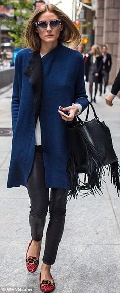 Equally stylish: The 28-year-old slipped on leather trousers earlier in the day...