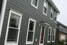 Iron Gray James Hardie and pretty red door. All with Opal Enterprises! House Cladding, House Siding, House Paint Exterior, Exterior House Colors, Exterior Design, Hardie Board Siding, Grey Siding, House Color Schemes, Colour Schemes