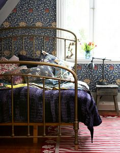 Mixing patterns in the bed room; like combination of the vintage style bed frame…