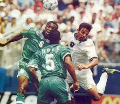 Italy 2 Nigeria 1 in 1994 in Boston. Chidi Nwanu heads away from Roberto Baggio in Round 2 at the World Cup.