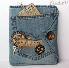 "Recycled jeans repurposed into a ""softbook"".  Inside are kraft paper pages with charming family photos.  This is delightful and manly at the same time.  By:  Lenulya: Denim kraft notebook"