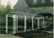 Hand forged wrought iron pergolas (also known as arbours or tunnel arches) are the ideal choice for the garden because they look lighter and more elegant than other materials. Iron Pergola, Gazebo Pergola, Pergola With Roof, Steep Backyard, Building A Patio, Concrete Jungle, Back Gardens, Play Houses, Wrought Iron