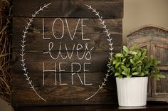 This love lives here pallet wood sign is approximately 12 square. Dark walnut stain or gray background with white hand painted lettering. Comes