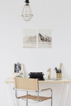 Minimalist office space | white walls + light wood with wall photo decor