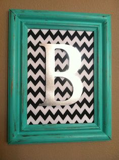painted initial in open frame w fabric/scrapbook paper background