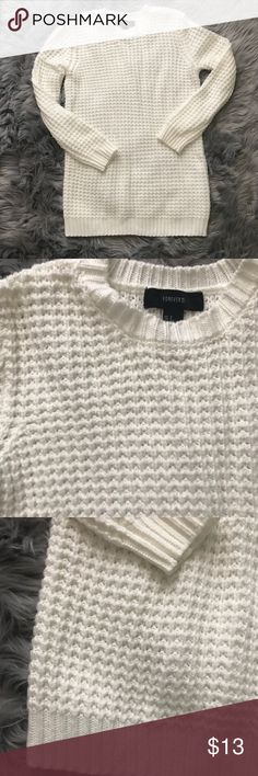 Forever 21 Cream Sweater This sweater is a nice creamy white color perfect for winter. It's never been worn but it would look great paired with leggings as it is a bit long. It feels warm, cozy, and soft. Forever 21 Sweaters