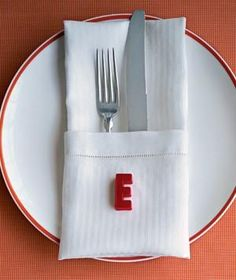 Mark playful place settings at a dinner party with alphabet magnets for each guest's first initial.