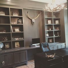 Office painted BM kendall charcoal, faux antler chandelier from cast antlers and the metallic steer skull from restoration hardware. #masculine #office #antlers #coastal #farmhouse