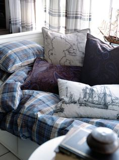 Kind of loving this little nook with these travel inspired pillows!