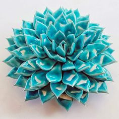 Self-taught artist Owen Mann creates ceramic blooms from dozens, and sometimes hundreds of petals, each hand-formed to mimic the appearance of peonies, dahlias, and spiraling succulents.