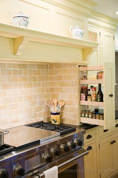 Spice/cooking oil pull-out built into mantle hood