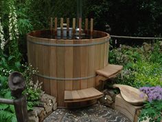 Cedar hot tub with immersed wood burning stove.