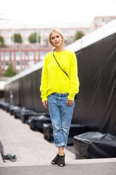 Dress up your old blue jeans with a bold neon jumper and statement studded heels, the perfect look to get you stylishly through the trick transpersonal period!