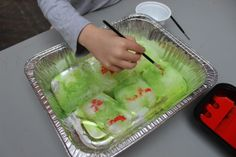 Painting salt and food dye onto ice