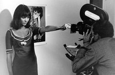 "gowns: anna karina playfully pushes back godard's camera (shooting ""pierrot le fou"" in '65)"