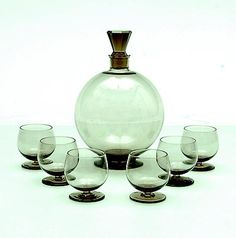 Liqueur-carafe with facet cut stopper with six liqueur-glasses from the service Wijnbes design A.D.Copier 1929 executed by Glasfabriek Leerdam / the Netherlands