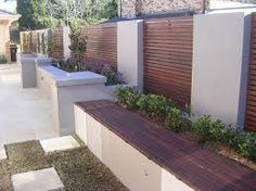mixed wooden fence and rendered wall